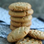 peanut butter cookies stacked on a cloth napkin