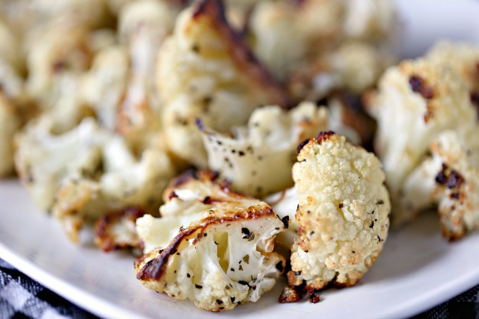 close up image of roasted cauliflower on a white plate