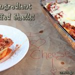 Stuffed Shells cooked in a casserole dish and served with extra cheese!
