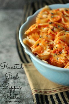 Roasted Red Pepper Pasta in a blue bowl on a cloth napkin.
