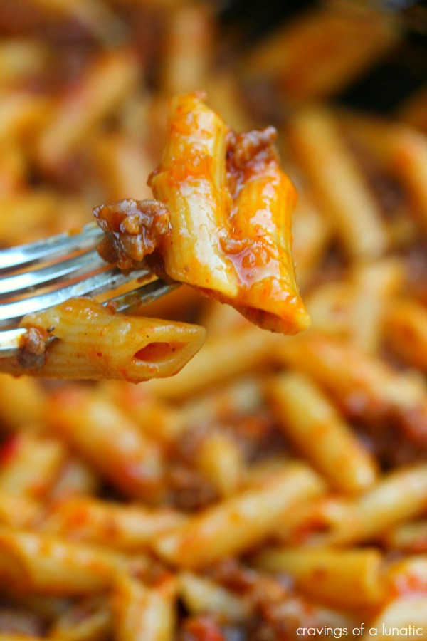 close up image of Roasted Red Pepper and Italian Sausage Pasta with a forkful of pasta being lifted up