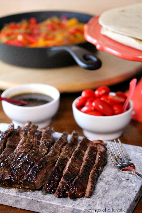 Steak Fajitas with Drunken Peppers ingredients spread out on a table.