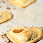 Apple Hand Pies on parchment paper