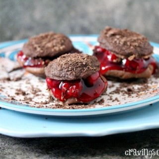 Black Forest Sandwich Cookies   Cravings of a Lunatic   Seriously scrumptious chocolate cookies filled with chocolate frosting and cherries
