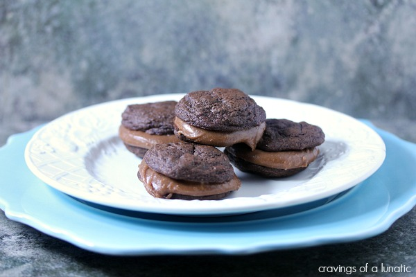Chocolate Fudge Brownie Sandwich Cookies stacked on blue and white plates.