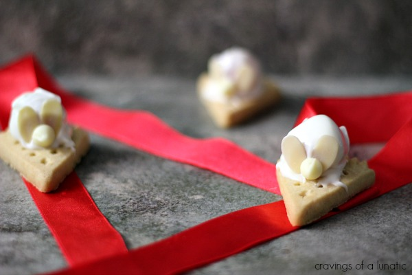 Shortbread Christmas Mice on counter with red ribbon scattered about