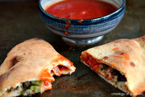 Homemade Calzones are packed with incredibly delicious ingredients and baked in the oven till golden brown.
