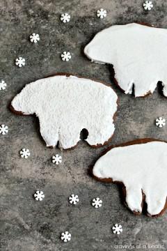 Gingerbread Polar Bear Cookies on a dark surface.