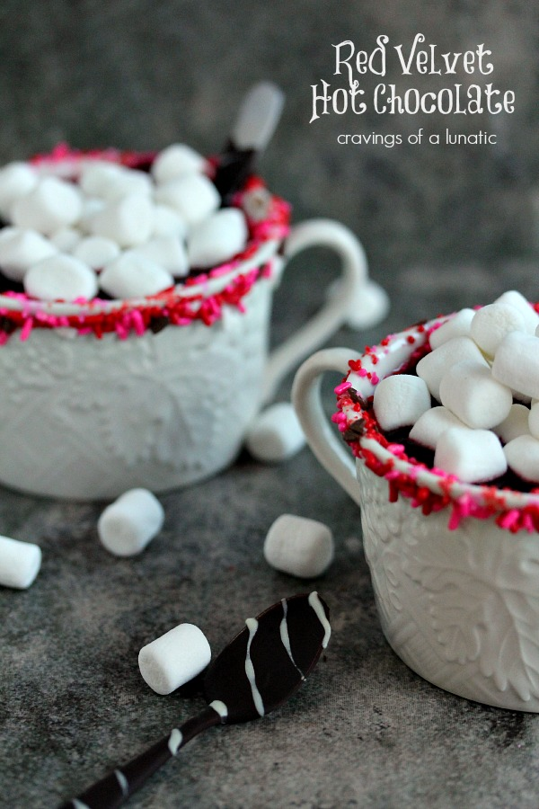 Red Velvet Hot Chocolate- Easy to make red velvet hot chocolate recipe. Simply delightful to sip on a cold day. Curl up with a mug of this, a good book, a cozy blanket and roaring fire nearby.