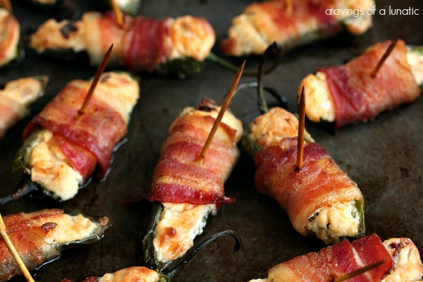 Jalapeno poppers stuffed with cheese and wrapped in bacon