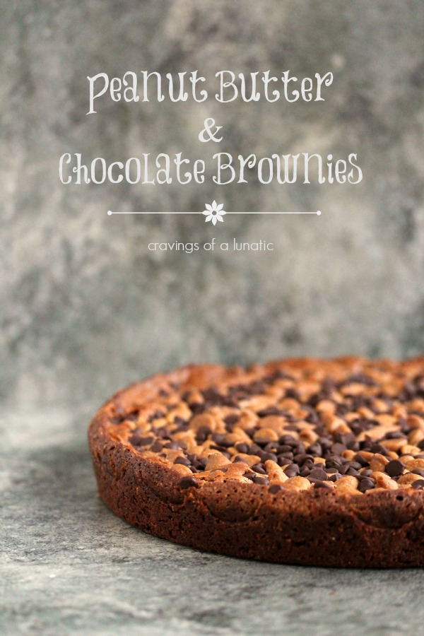 Peanut butter and chocolate brownies cooked in a round pan and set on a tile surface with text stating the recipe and blog name at the top of the image.