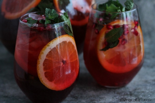 Pomegranate Party Punch in wine tumblers.
