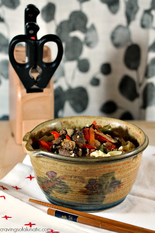 Steak Stir Fry on a table with knife block in background