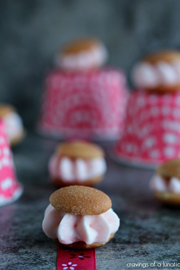 Pink Lemonade Miniature Ice Cream Sandwiches | Cravings of a Lunatic | Super tiny Nilla Wafers filled with pink lemonade cheesecake filling! Super cute and tiny!