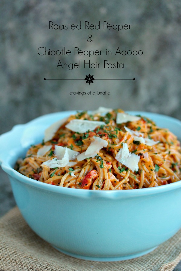 Roasted Red Pepper and Chipotle Pepper in Adobo Angel Hair Pasta served in a blue bowl and topped with parmesan cheese