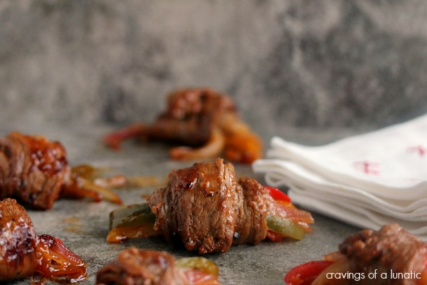 Western Style Steak Rolls from cravingsofalunatic.com- This is an easy recipe for steak rolls with a western style flair. These steak rolls are filled with peppers and onions and covered in barbecue sauce. Seriously scrumptious recipe that is simple to make.