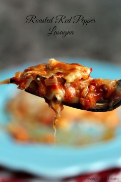 Roasted Red Pepper Lasagna close up image of pasta on fork with plate of it in the blurred background.