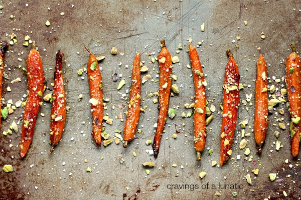 Roasted Carrots with Honey and Pistachios on a cookie sheet