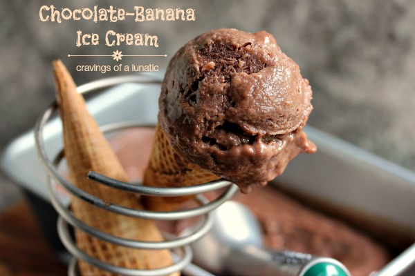 Chocolate banana ice cream in waffle cones in a metal ice cream holder with a metal pan full of ice cream in the background. Text in upper left corner states recipe name and blog name.