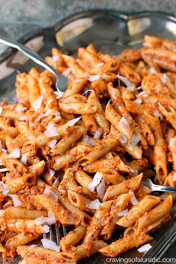 Penne Pasta with Sun-Dried Tomato Pesto served on a silver platter.