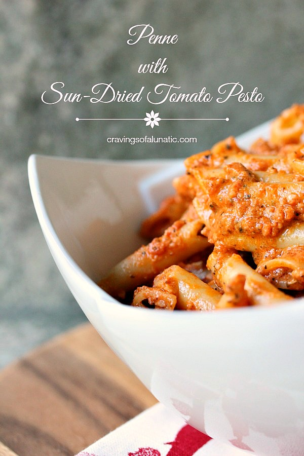 Penne Pasta with Sun-Dried Tomato Pesto served in a white bowl.