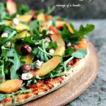Pizza with Arugula, Peaches and Hazelnuts
