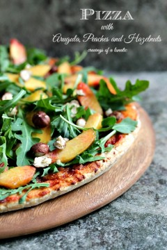 Pizza with Arugula, Peaches and Hazelnuts from cravingsofalunatic.com- Amazing Pizza layered with Arugula, Fresh Peaches, and Chopped Hazelnuts. This recipe is a real crowd pleaser and perfect for summer! (@CravingsLunatic)