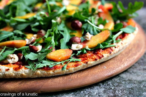 Pizza with Arugula, Peaches and Hazelnuts