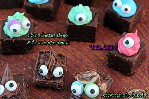 chocolate fudge cute into pieces and decorated to look like tiny monsters with icing and googly eyes