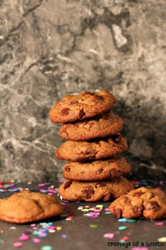 Chocolate Fudge Brownie Cookies stacked with random cookies around them.