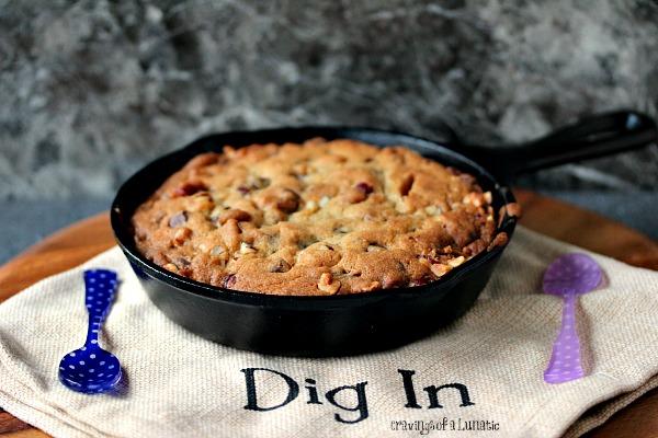 "Chocolate Hazelnut Skillet Cookie on a beige napkin that has ""dig in"" written on it"