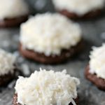 Chocolate coconut cookies on a grey marble surface.