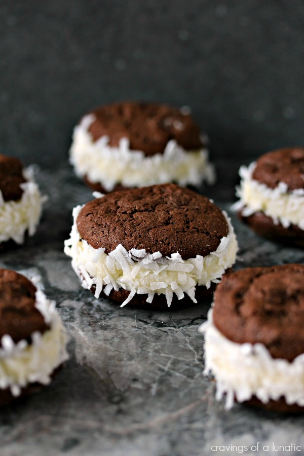 Coconut Filled Sandwich Cookies on a grey counter.
