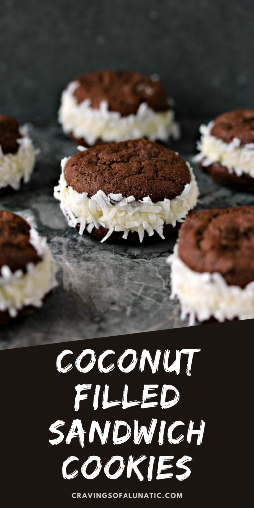 Coconut Filled Sandwich Cookies scattered on a grey marble counter.