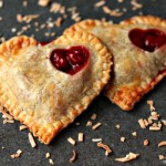 Toasted Coconut and Cherry Hand Pies | These little toasted coconut and cherry hand pies are absolutely scrumptious. Plus they are incredibly easy to make which is a huge perk!