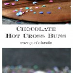 Chocolate Hot Cross Buns on a wood board with confetti all around.