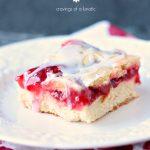 Cherry Bars aka Cherry Kuchen on a white plate
