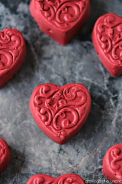 Red Velvet Fudge shaped like hearts and cooling on a grey counter.