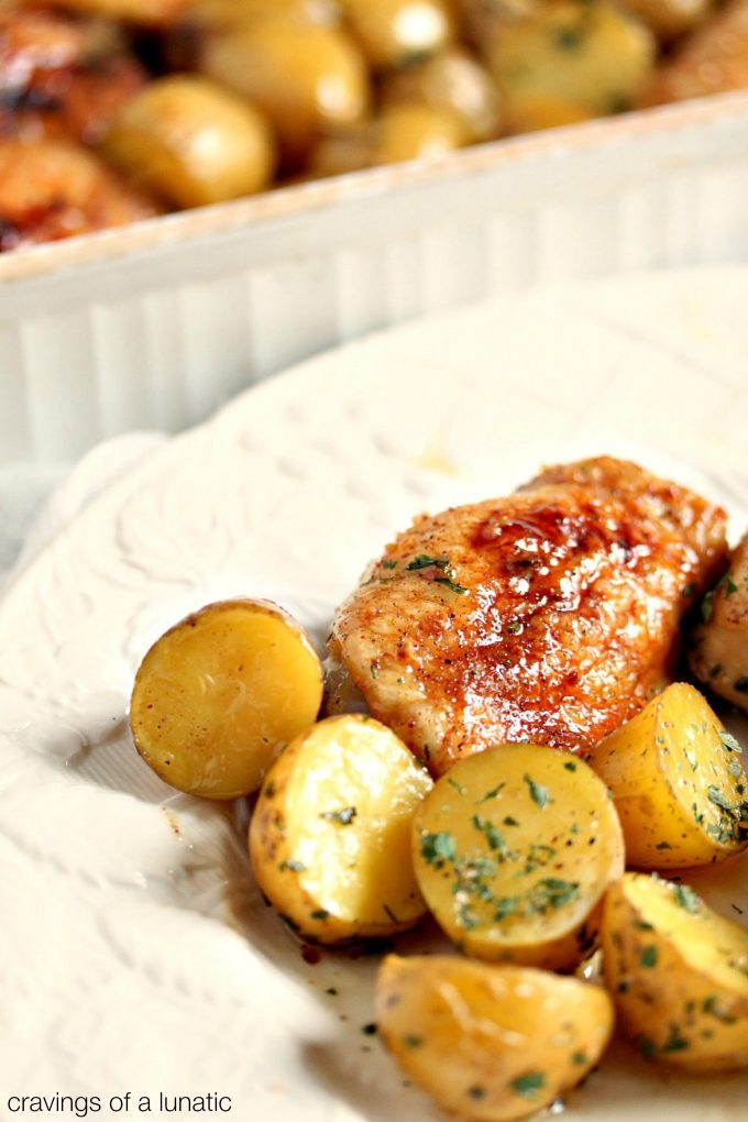 Honey Baked Chicken and Potatoes served on a white plate