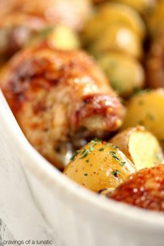 Honey Baked Chicken and Potatoes baked in a white baking dish