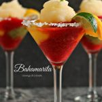 close up image of frozen margarita made with Tequila, kiwi, strawberry and mango ices and served with a shot of Cactus Juice Schnapps