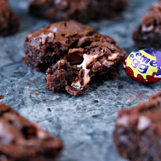 Creme Egg Brownies- Ooey, gooey, fudgy chocolate brownies filled with creme eggs. Get the recipe at cravingsofalunatic.com