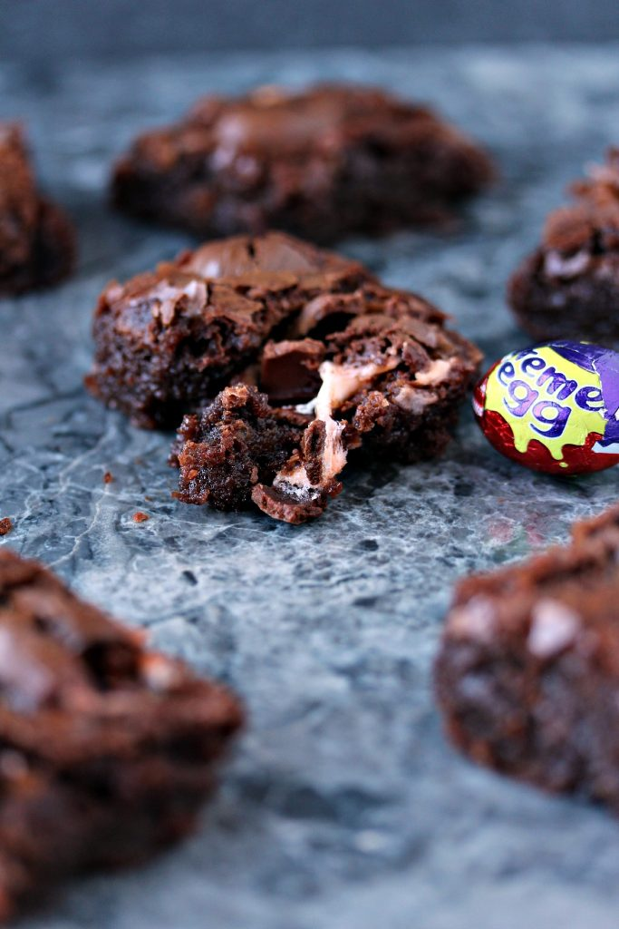 Creme Egg Brownies cooling on a grey counter