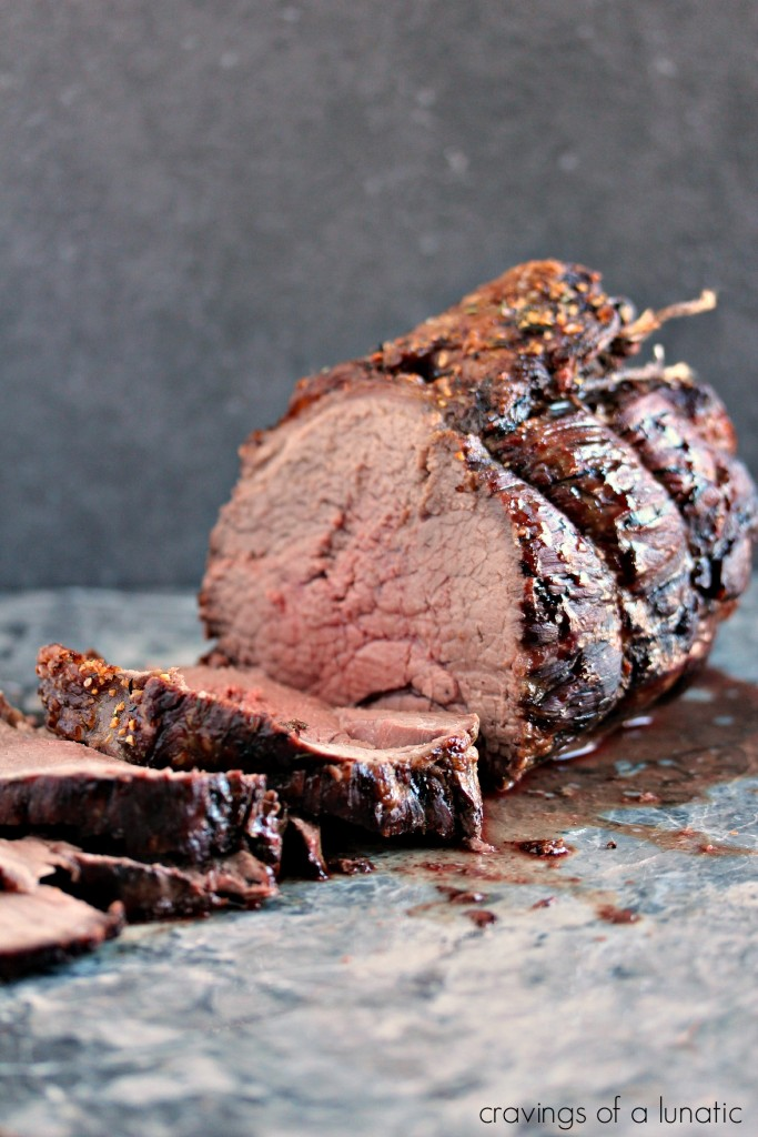 Top Sirloin Beef Roast cooked to perfection and being sliced on a grey marble counter