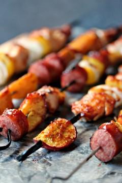 Chicken, Peach and Sausage Kebabs on black skewers