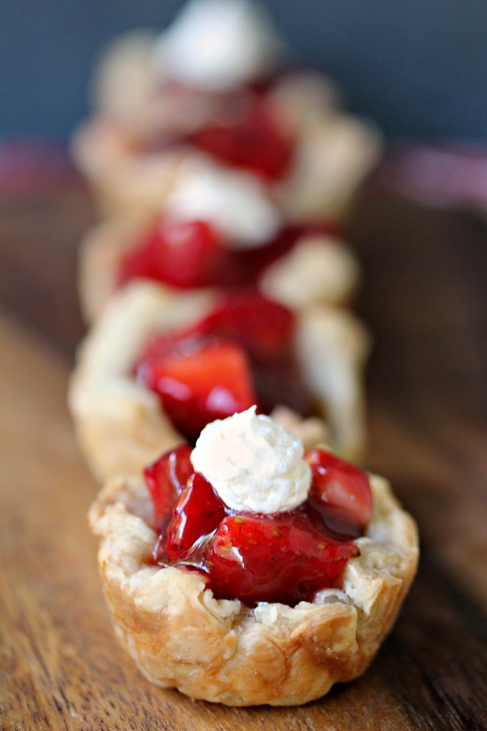 Strawberry Filled Mini Puff Pastries on a wooden board