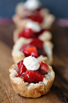 Strawberry Filled Mini Puff Pastries- Mini Puff Pastry Cups filled with Smucker's® Fruit & Honey Fruit Spread and Fresh Berries. Cute, easy and utterly delicious!