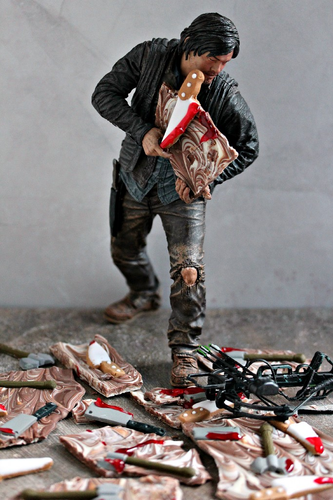 Daryl Dixon statue made to look like it's holding and eating Chocolate Weapons Bark