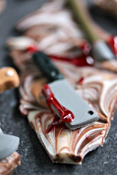 Chocolate Weapons Bark- Even during the apocalypse you're still going to crave chocolate. So make sure you're always prepared for zombie battles with this easy to make chocolate bark layered with zombie killing weapons. Try this Weapons Chocolate Bark for Dead Eats: Recipes Inspired by The Walking Dead!