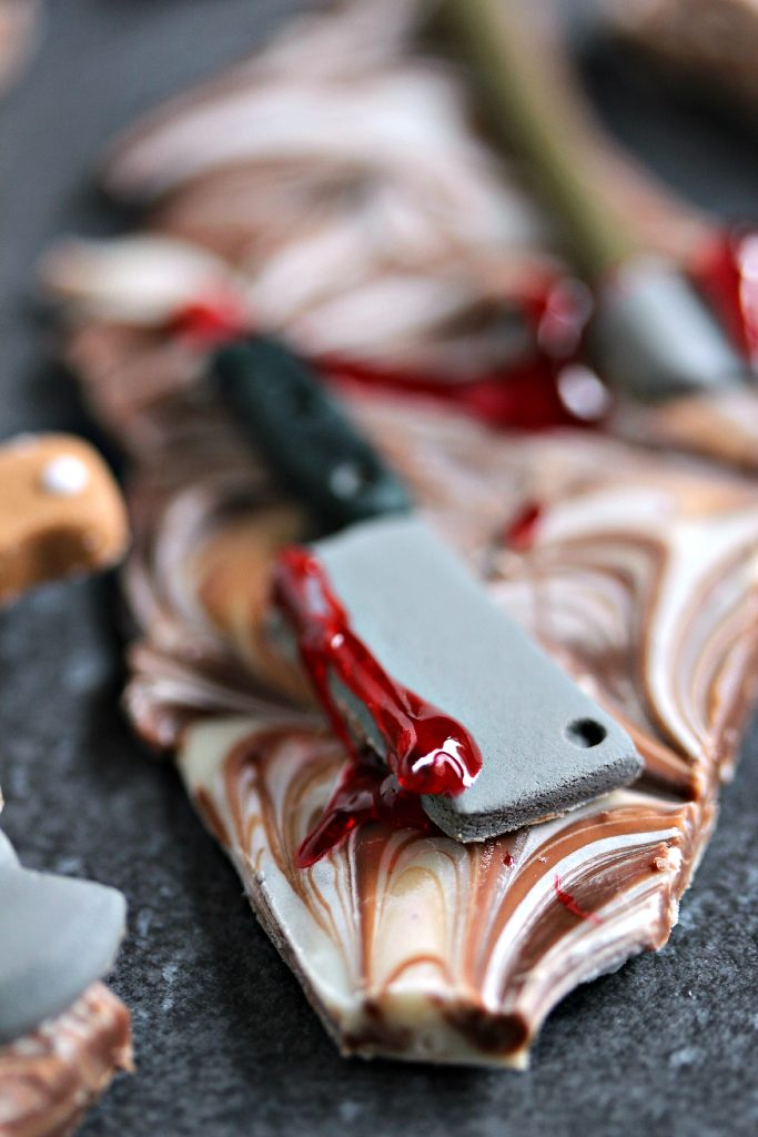 Chocolate Weapons Bark from cravingsofalunatic.com- Even during the apocalypse you're still going to crave chocolate. So make sure you're always prepared for zombie battles with this easy to make chocolate bark layered with zombie killing weapons. Try this Weapons Chocolate Bark for Dead Eats: Recipes Inspired by The Walking Dead! (@CravingsLunatic)